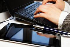 Office table with laptop and female hands Stock Photography