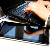 Office table with laptop and female hands Stock Photos