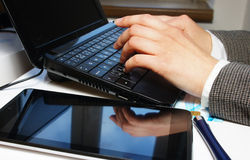 Office table with laptop and female hands Stock Images