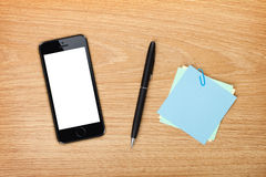 Office table with mobile phone and supplies Royalty Free Stock Photography