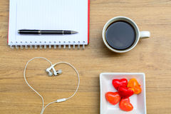 Office table with notebook and coffee cup. Royalty Free Stock Images