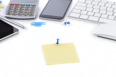 Office table with notebook, computer keyboard and mouse, tablet Stock Photo
