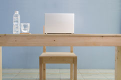 Office table with notebook and natural mineral water. View from Stock Photo