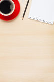 Office table with notepad and coffee cup Royalty Free Stock Photography