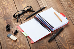 Office table with notepad, colorful pencils and supplies Stock Photography