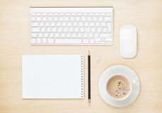 Office table with notepad, computer and coffee cup Royalty Free Stock Photos