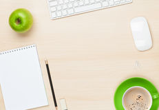 Office table with notepad, computer and coffee cup Royalty Free Stock Images