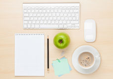 Office table with notepad, computer and coffee cup Stock Photos