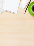 Office table with notepad, computer and coffee cup Royalty Free Stock Image