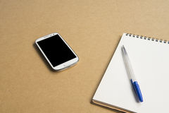 Office table with notepad Royalty Free Stock Photos