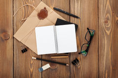Office table with notepad, vintage envelope and supplies Royalty Free Stock Photos
