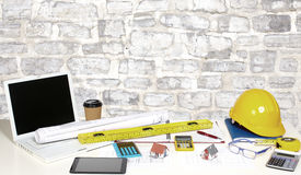 Office table with objects. Office table with business objects. Job and education over  wall of bricks background Royalty Free Stock Image