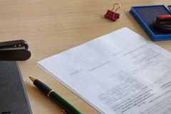 Office table with papers ready to sign royalty free stock photo