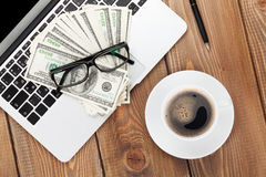 Office table with pc, supplies and money cash Royalty Free Stock Images