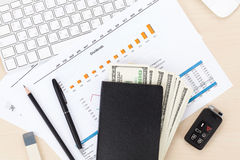 Office table with pc, supplies and money cash Royalty Free Stock Photo