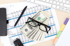 Office table with pc, supplies and money cash Stock Images