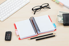 Office table with pc, supplies and money cash Stock Image