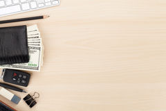 Office table with pc, supplies and money cash Stock Photos