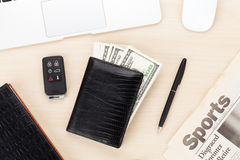 Office table with pc, supplies, newspaper and money cash Royalty Free Stock Photo