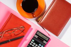Office table with pen, calculator. Colour. Flat lay top view royalty free stock photos