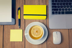 Office table with tea cup. View from above Stock Photo