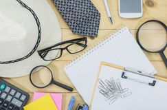 Office table top view with the glasses, note book. stock images