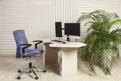 Office desk for sitting and standing. An office table with two manitors, a lifting mechanism for the holder of the manitor and a tabletop behind which you can royalty free stock images