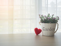 Free Office Table With Pink Rose Flower On Flowerpot And Red Heart Sh Royalty Free Stock Image - 92885796