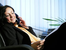 Office talk 3. Young woman havinga phone conversation royalty free stock images