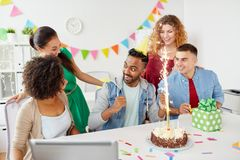 Office team greeting colleague at birthday party Royalty Free Stock Image