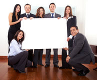 Office team holding a cardboard Stock Photo