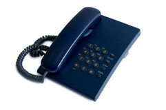 Office  telephone. Ordinary office dark blue telephone isolated on a white background Stock Images