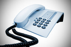 Office telephone. Office telephone over white with vignetting Royalty Free Stock Photography