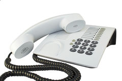 Office telephone. Office telephone with sinuous cord isolated on white Royalty Free Stock Photo