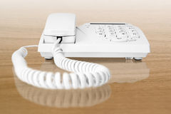 Office telephone. White office telephone on table Stock Image
