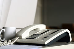 Office Telephone. A telephone in an office with blurred background Stock Images