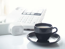 Office telephone and cup Royalty Free Stock Photos