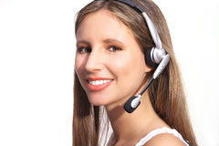 Office telephone operator, beautiful woman with headphones. On white background Stock Photography