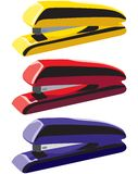 Office tool. Stapler machines are in different colors Royalty Free Stock Photo