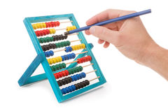 Office tool abacus for accounts. Hand with pencil dials. Close-up royalty free stock images