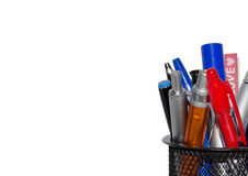 Office tool - color pens in a black basket, empty space, isolated on white background Royalty Free Stock Photography