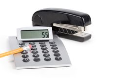 Office tools. Calculator and stapler over white Royalty Free Stock Photo