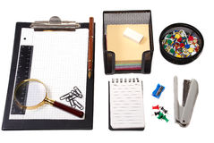 Office tools. Magnifier, paper clips, a notebook, pencils Royalty Free Stock Photo