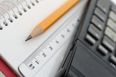 Office tools. Pencil, ruler and calculator on drawing pad Royalty Free Stock Photo