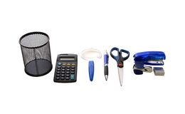 Office Tools. A variety of office tools including utility holder, pen, scissors, stapler, and calculator - path included Royalty Free Stock Photos