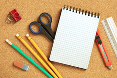 Office tools. Close up view of the office tools on cork board Royalty Free Stock Images