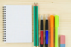 Office tools with blank notebook on wooden table Stock Photo