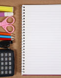 Office tools on cork board Royalty Free Stock Image