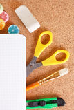 Office tools on cork board Royalty Free Stock Photo