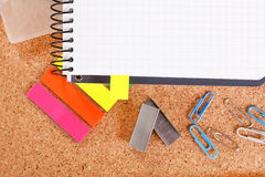 Office tools on cork board Royalty Free Stock Photos